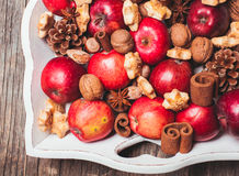 Aroma Christmas. Apples, cones, nuts and cookies with spices. Aroma Christmas Royalty Free Stock Images