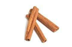 Aroma cinnamon sticks on a white background. Stock Photo