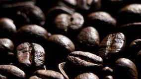 Aroma of coffee beans. Rotating. Close up. Backlight stock video footage