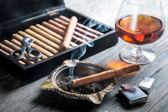 Aroma of cognac and cigar fuming Stock Photo