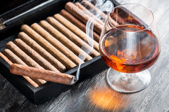 Aroma of cognac and smoking a cigar Royalty Free Stock Photo