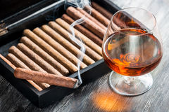 Aroma of cognac and smoking a cigar Stock Photo