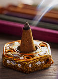 Aroma cone in a stand with aroma sticks Stock Photos