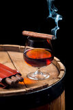Aroma of Cuban cigars and cognac on black background Royalty Free Stock Photo