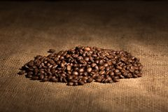 Aroma flavor coffee grains, beans on textured background Stock Images