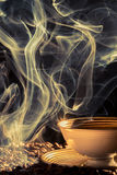 Aroma of freshly brewed coffee. On black background Stock Images