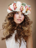 Aroma. Genuine Brunette in Wreath of Flowers Looking Up Royalty Free Stock Image