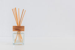 Aroma glass bottle  and perfume stick. S on the table Royalty Free Stock Photo