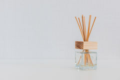 Aroma glass bottle  and perfume stick. S on the table Stock Photos