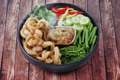 Aroma of green chili dip as Nam Prik Num served side dish. Aroma of green chili dip as Nam Prik Num in Thai with crispy pork rind ,spicy pepper,boiled cow-pea royalty free stock photography