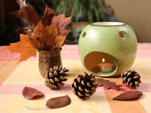 Aroma lamp. Autumn arrangement with aroma lamp royalty free stock photography