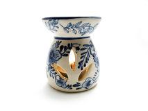 Aroma lamp with burning candle stock image