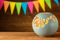 Aroma lamp. Candle holder blue globe on the background of festiv. E flags. Greeting card Stock Photography