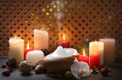 Aroma lamp and candles. On table stock photo