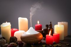 Aroma lamp and candles. On table royalty free stock images
