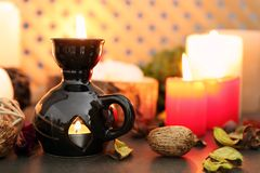 Aroma lamp and candles on table royalty free stock image