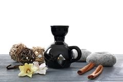 Aroma lamp and decor on table. Against white background stock photo