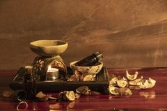 Aroma lamp with essential oil and potpourri on wooden table background royalty free stock photos
