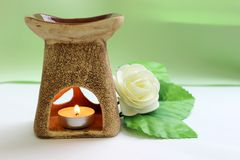 Scented lamp with flower and candles stock images