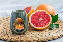 Aroma lamp with grapefruit essential oil, spa background, horizontal Royalty Free Stock Photography