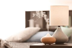 Aroma lamp on table royalty free stock photography