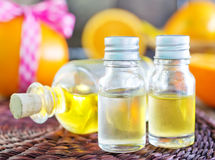 Aroma oil. In bottle and on a table Royalty Free Stock Photos