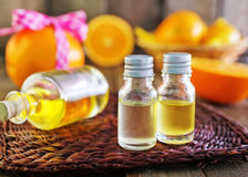 Aroma oil. In bottle and on a table Royalty Free Stock Photo