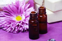 Aroma Oil Bottles. With Flower and Soap Background Stock Photos