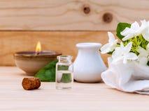 Aroma oil bottles arranged with jasmine flowers . Stock Photo