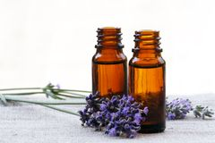 Aroma Oil in Bottles with Lavender. Aromatherapy Aroma Oil in Glass Bottles with Lavender Stock Photo