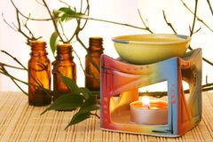 Aroma Oil Bowl and Bottles. Oil Bowl Burner and Bottles Aromatherapy Concept Stock Image