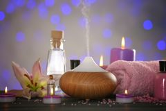 Aroma oil diffuser and candles royalty free stock photography