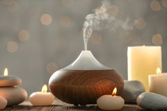 Aroma oil diffuser and candles royalty free stock images