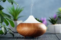 Aroma oil diffuser. On wooden table Stock Images