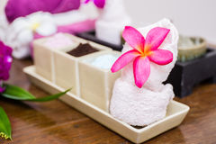 Aroma oil, facial cream, powder, towel on table Royalty Free Stock Photos