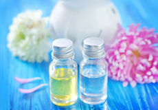Aroma oil. And flowers on a table Stock Photography