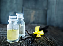 Aroma oil. In glass bowl and on a table Stock Image