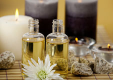 Aroma oils and candles. With stones on a bamboo background Stock Images