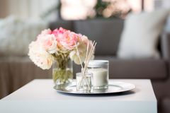 Free Aroma Reed Diffuser, Candle And Flowers On Table Stock Photo - 160470400