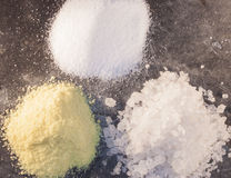 Aroma-, rock and ordinary salt. On a stone plate Royalty Free Stock Image