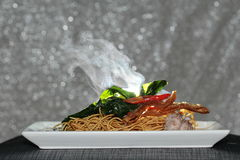 Aroma smell of crispy noodle topped kale soup with meatball and spicy sauce. Selective focus. Royalty Free Stock Photo