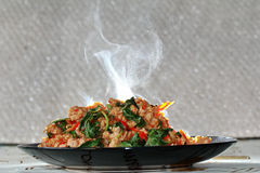 Aroma smell fried spicy basil with minced pork topped lettuce. Royalty Free Stock Photo