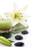 Aroma Spa Set. Aromatherapy lily spa set -  lily flowers, aroma candle, spa stones and and towels over white background best suited for relaxing and health Stock Photo