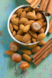 Aroma spices. Cinnamon, almonds and hazelnuts. Royalty Free Stock Photos