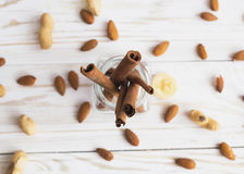 Aroma spices. Cinnamon, peanuts and almonds Royalty Free Stock Image