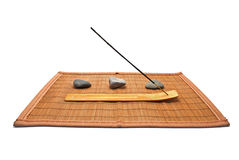 Aroma-stick. Aroma-stick on the stand and the smooth stones on a wooden mat, isolated on white Stock Images