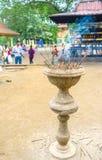 The aroma stick vase. PERADENIYA, SRI LANKA - NOVEMBER 28, 2016: The vase for aroma sticks located in the courtyard next to the entrance to Gatambe Viharaya, on Royalty Free Stock Photography