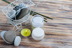 Aroma sticks, pebbles and lit candle Royalty Free Stock Photo