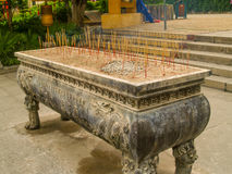 Aroma sticks stand near Buddhist temple Stock Photo