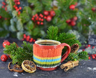 Aroma still life with knitted cup and cinnamon Royalty Free Stock Photography